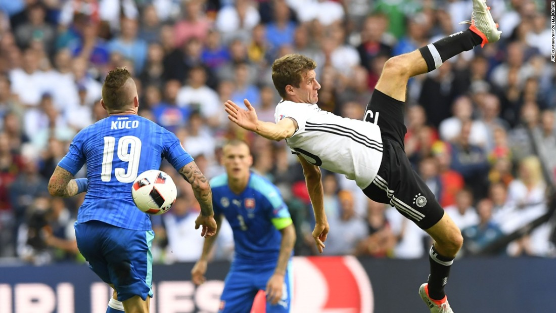 Germany's midfielder Thomas Mueller, right, challenges Slovakia's midfielder Juraj Kucka.