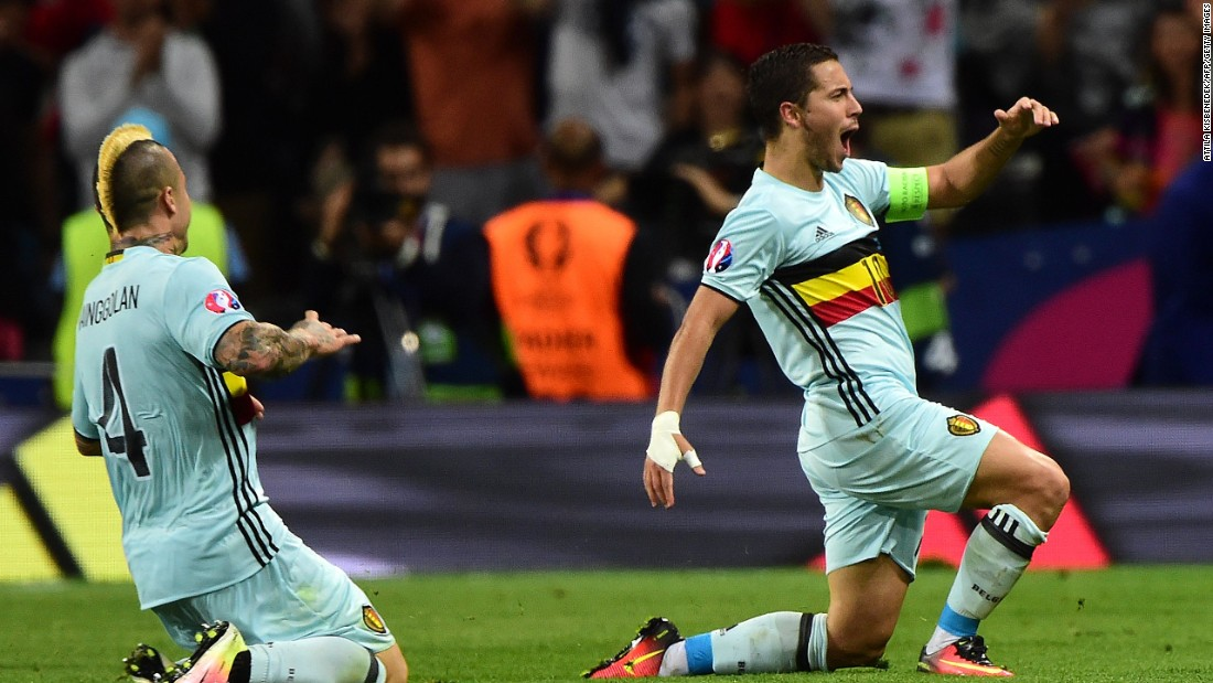 Belgian forward Eden Hazard, right, celebrates after scoring his team's third goal.