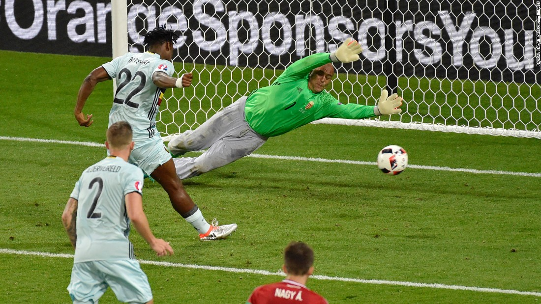 Belgian forward Michy Batshuayi, left, scores past Hungarian goalkeeper Gabor Kiraly.