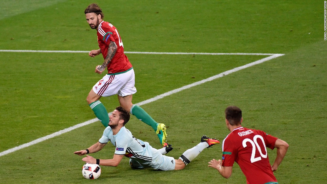 Hungarian defender Tamas Kadar, left, fouls Belgian forward Dries Mertens.