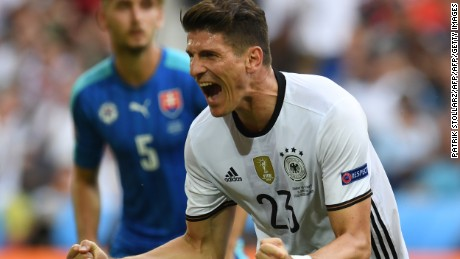 Germany's forward Mario Gomez celebrates after scoring a goal during the Euro 2016 round of 16 football match between Germany and Slovakia at the Pierre-Mauroy stadium in Villeneuve-d'Ascq near Lille on June 26, 2016. / AFP / PATRIK STOLLARZ        (Photo credit should read PATRIK STOLLARZ/AFP/Getty Images)