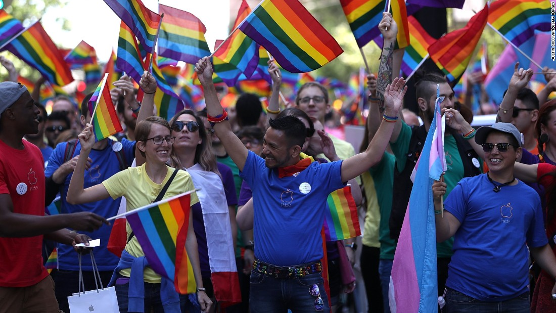 Parade participants wave flags at the march during the 2016 San Francisco Pride Parade on Sunday, June 26. Hundreds of thousands of people came out to watch the event, one of the largest in the world.