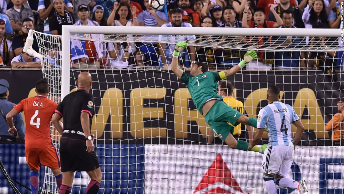 Chile's goalkeeper Claudio Bravo pulls off a save following a header by Argentina's Sergio Aguero (out of frame).