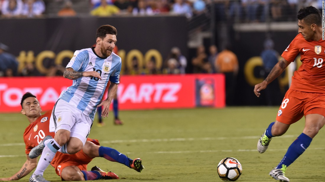 Argentina's Lionel Messi is marked by Chile's Charles Aranguiz, left.