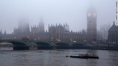The Houses of Parliament and the river Thames are shrouded in early morning fog on January 21, 2014 in London, England.