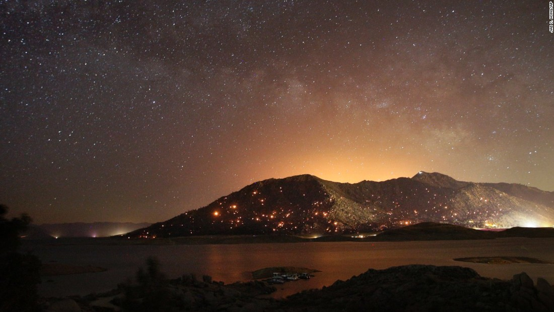 "Embers burn on a mountain as firefighters <a href=""http://www.cnn.com/2016/06/24/us/california-erskine-fire/"" target=""_blank"">battle a wildfire</a> in the area near Lake Isabella, California, on Friday, June 24."