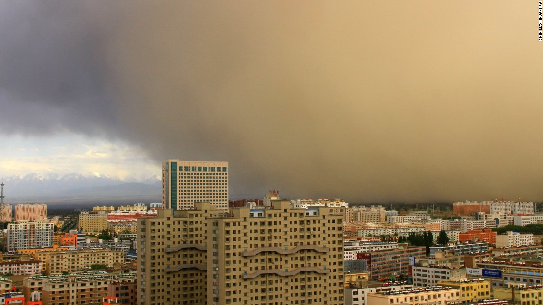 Buildings are shrouded in sand and dust in Zhangye, China, on Friday, June 3.
