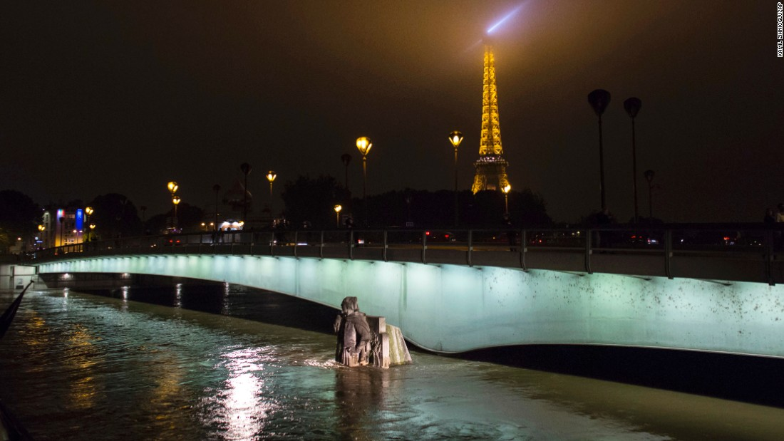 "The Zouave statue at the Pont de l'Alma bridge, which serves as a measuring instrument for water levels during floods, is partly covered by the Seine River in Paris on Friday, June 3. The Seine River <a href=""http://www.cnn.com/2016/06/03/europe/france-germany-flooding-art/"" target=""_blank"">spilled into Paris streets,</a> forcing many landmarks to shut down as it surged to its highest levels in nearly 35 years."