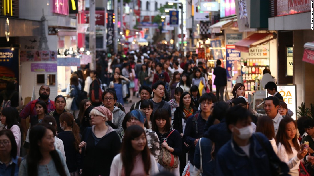 People walk along a shopping street in the Harajuku area of Tokyo, Japan, which came in fifth place.