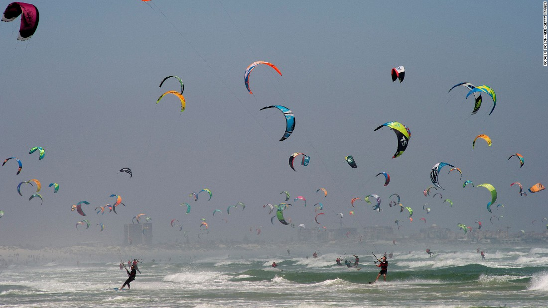 Kite surfers take part in the Kitesurfing Armada in Cape Town, South Africa.