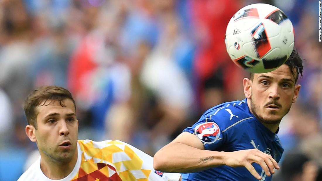 Spanish midfielder Koke, left, eyes the ball next to Italy's Alessandro Florenzi.