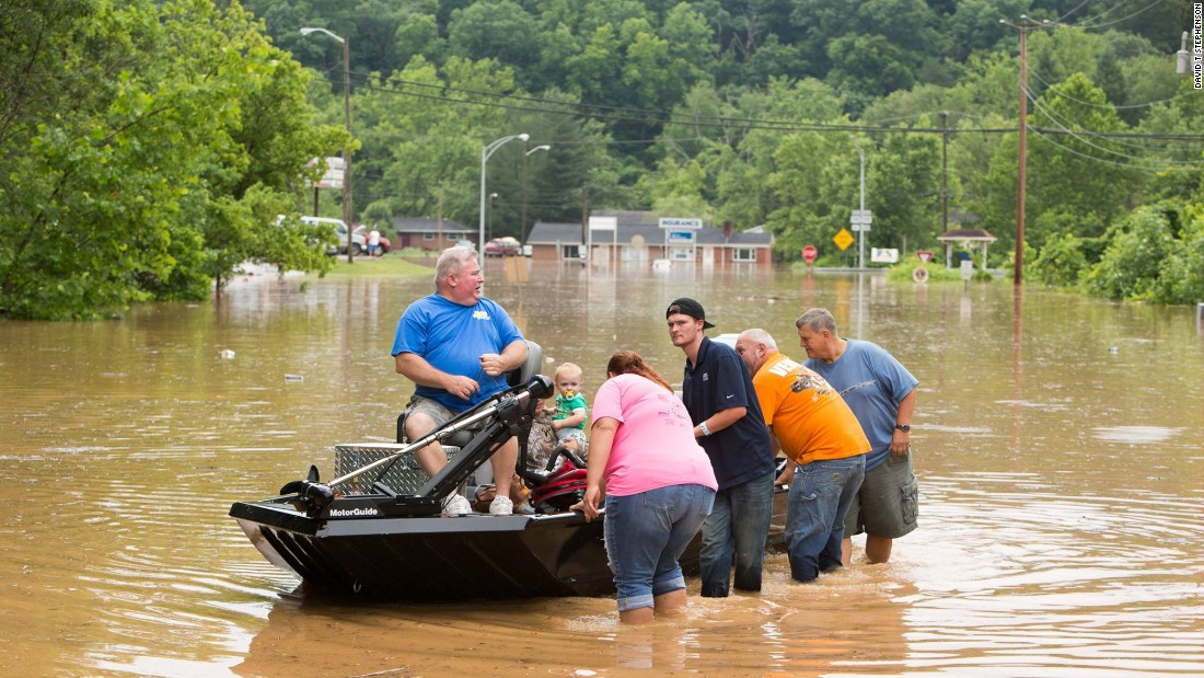 "People are transported on a boat during flooding in West Virginia on Sunday, June 26. <a href=""http://www.cnn.com/2016/06/25/us/west-virginia-flooding-deaths/"" target=""_blank"">Fast-moving floodwaters</a> have killed at least 24 people, state officials said."