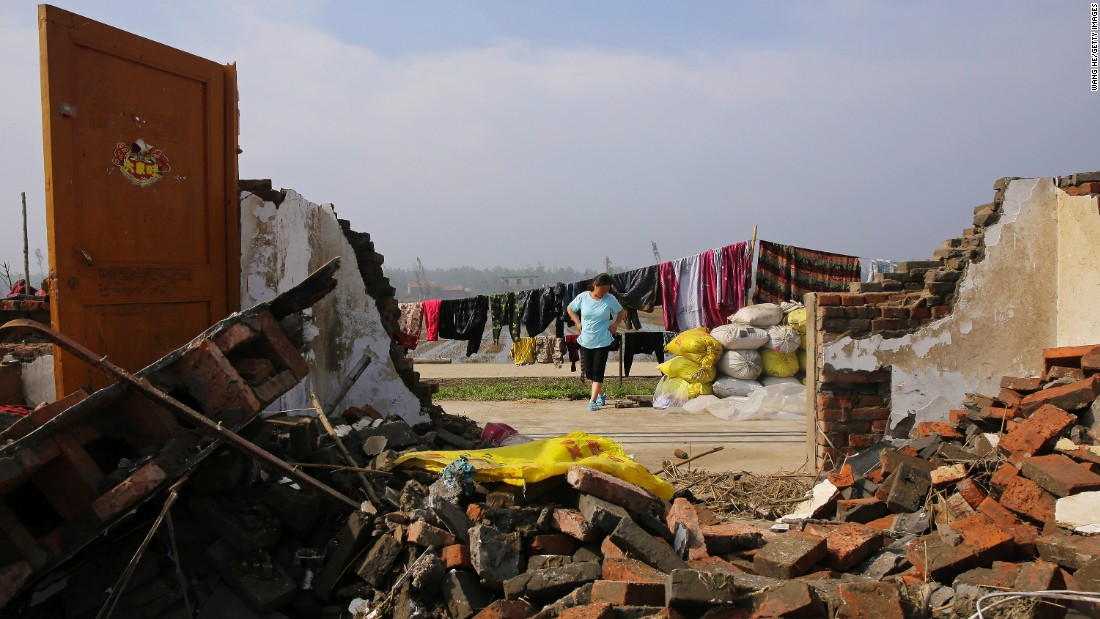 "A villager dries clothes in China's Jiangsu Province on Saturday, June 25. <a href=""http://www.cnn.com/2016/06/23/asia/china-tornado/"" target=""_blank"">At least 98 people were killed and 800 more were injured</a> after a tornado -- accompanied by hailstorms, thunderstorms and lightning -- hit eastern China, the government said."