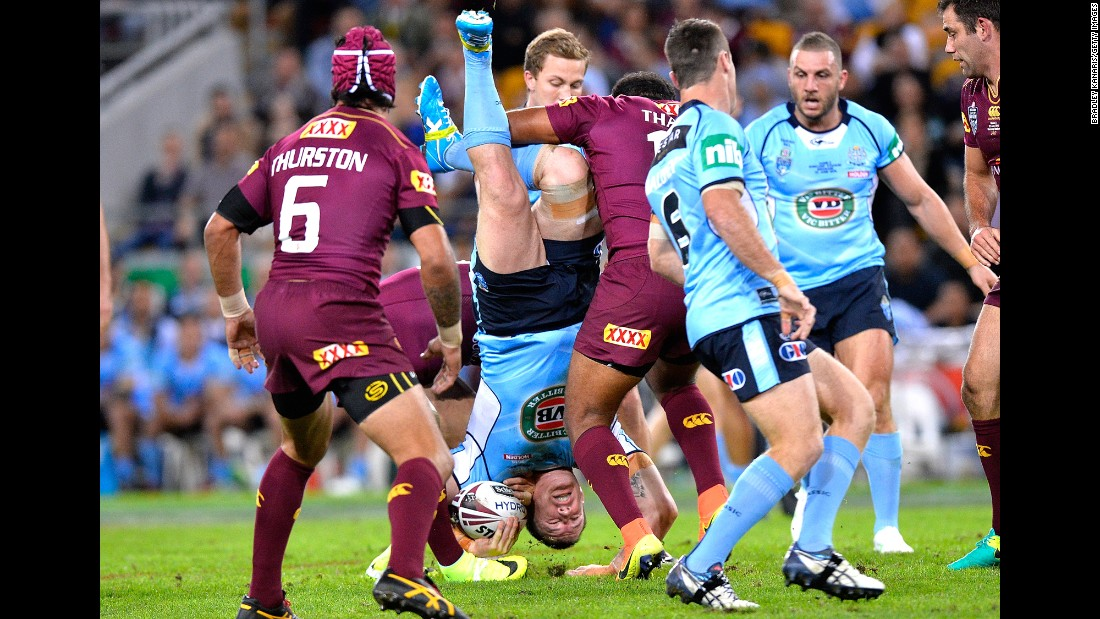 Paul Gallen, a rugby player for New South Wales, is tackled by Queensland's Sam Thaiday during game two of the State of Origin series on Wednesday, June 22. Queensland won 26-16 in Brisbane, Australia.