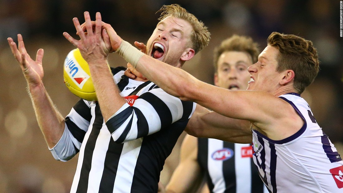 Jonathon Marsh of the Collingwood Magpies, left, and Matt Taberner of the Fremantle Dockers compete for the ball during an Australian Football League match in Melbourne on Friday, June 24.