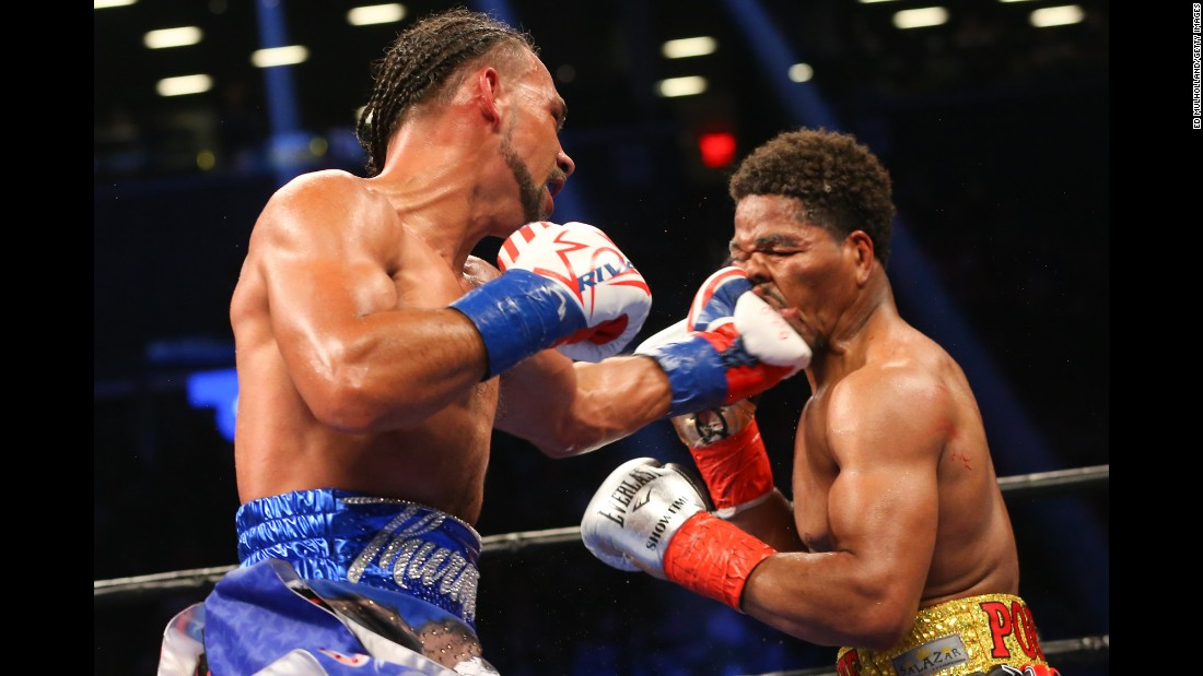 Keith Thurman lands a left hand to the head of Shawn Porter during their welterweight title fight in New York on Saturday, June 25. Thurman won by unanimous decision to retain his WBA belt.