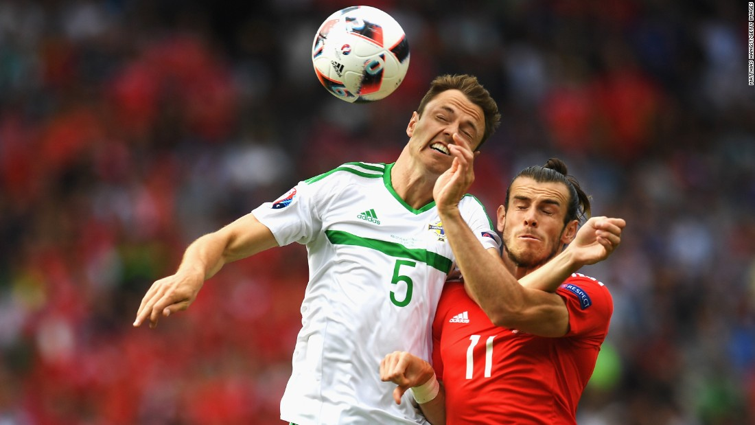 Northern Ireland's Jonny Evans, left, competes for a header with Wales' Gareth Bale during a match in Paris on Saturday, June 25. Wales won 1-0 to advance to the quarterfinals of Euro 2016.