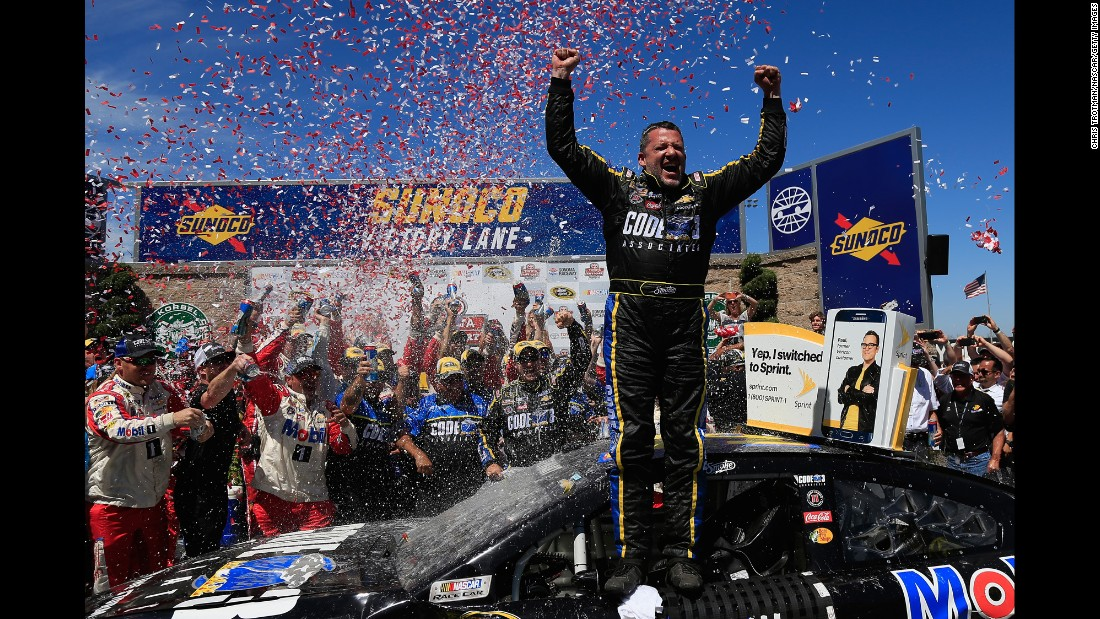 NASCAR driver Tony Stewart celebrates after winning the Sprint Cup race in Sonoma, California, on Sunday, June 26.
