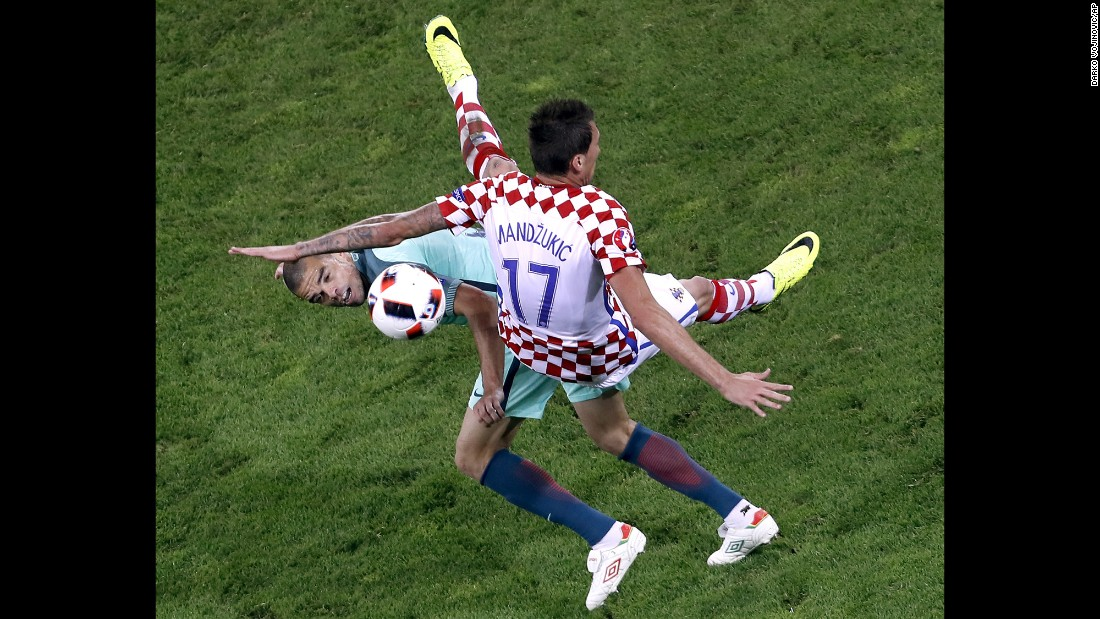 Portugal's Pepe, left, collides with Croatia's Mario Mandzukic during their round-of-16 match at Euro 2016. Portugal advanced with a 1-0 victory in extra time.