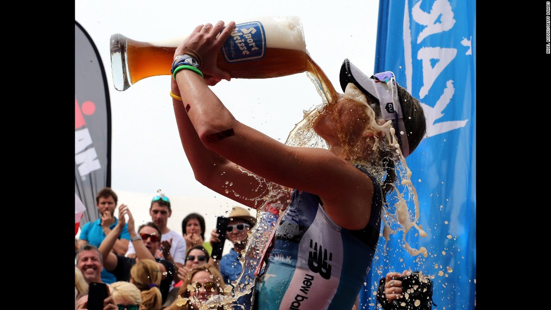 Australian triathlete Mirinda Carfrae celebrates she won the Ironman race in Klagenfurt, Austria, on Sunday, June 26.