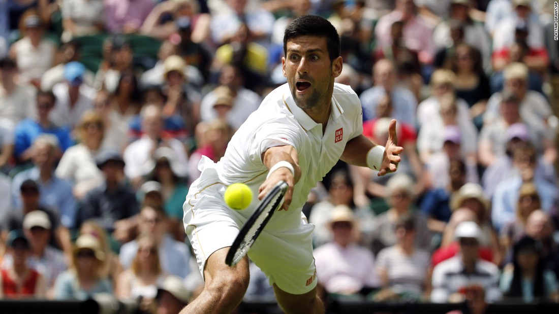 Novak Djokovic plays a shot during his first-round match at Wimbledon on Monday, June 27. Djokovic, who has won the last four Grand Slams, defeated James Ward in straight sets.