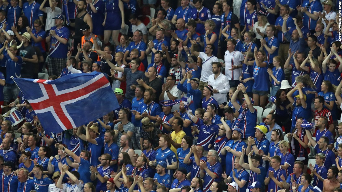 Iceland supporters cheer on their team at the stadium in Nice, France.