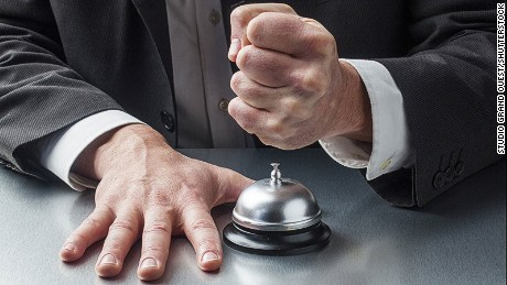 Angry hotel guest ringing bell