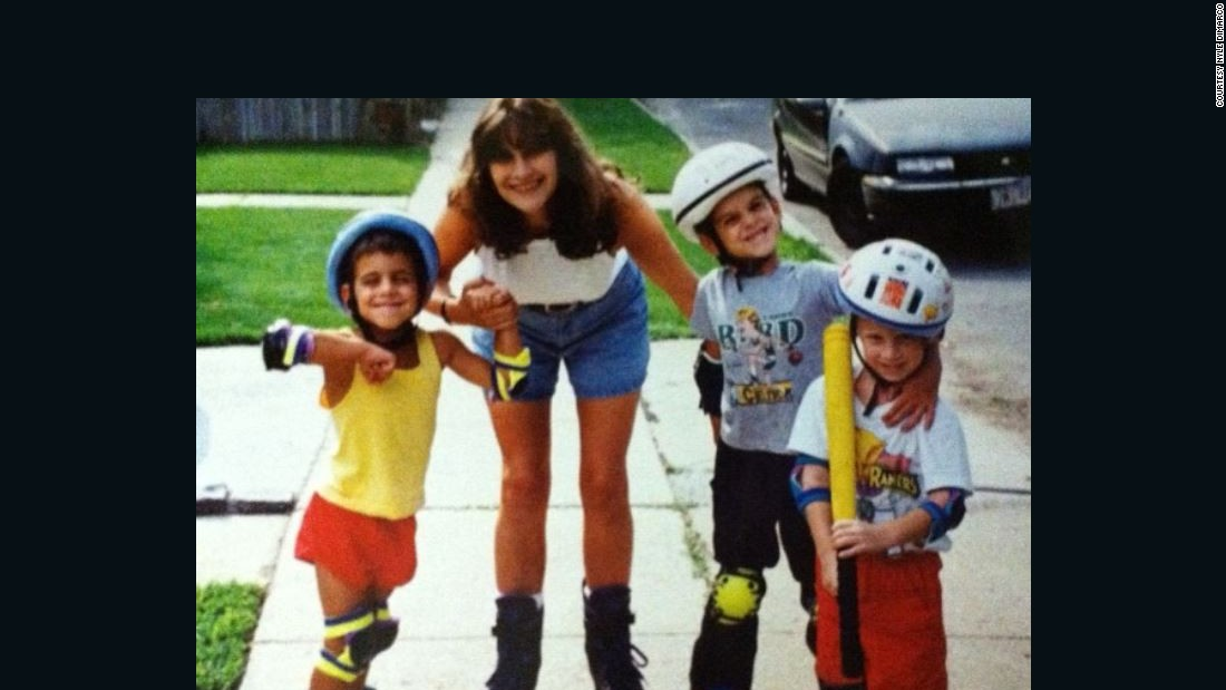 DiMarco, left, rollerblading with his mom and brothers.