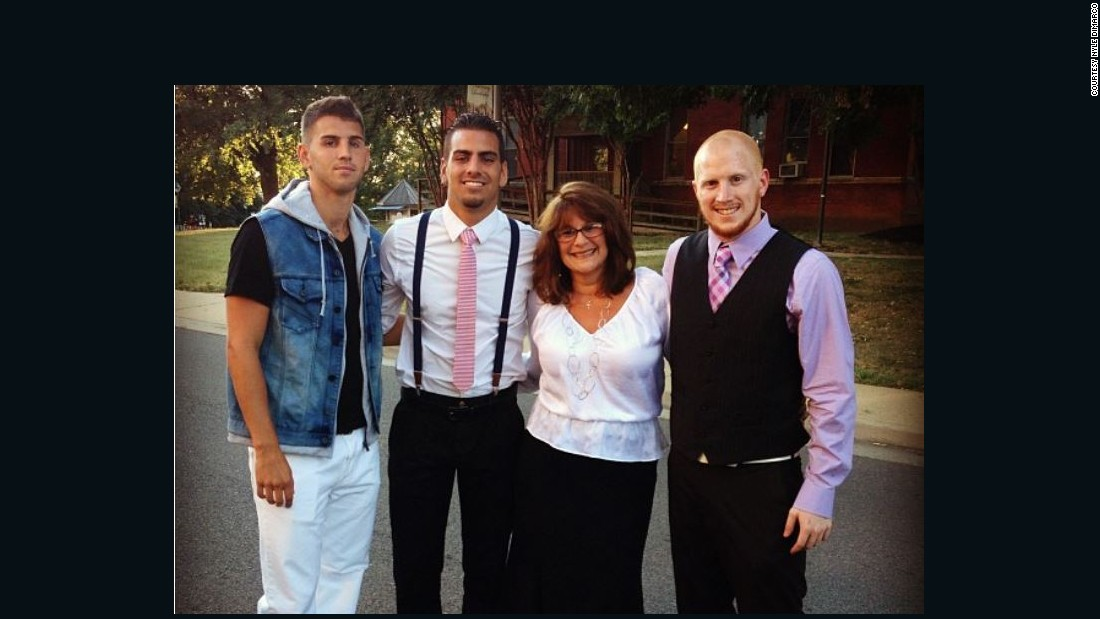 DiMarco, second from left, with his mom and two brothers at Gallaudet University in Washington, D.C.