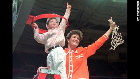 FILE - In this March 31, 1996, file photo, Tennessee coach Pat Summitt and son Tyler, 5, take down the net after winning the NCAA Women's Final Four championship basketball game against Georgia 83-65 at the Charlotte Coliseum in Charlotte, N.C. Tyler now works with the Tennessee Lady Vols as a practice player and has ambitions of following his mom into coaching. (AP Photo/Pat Sullivan, File)