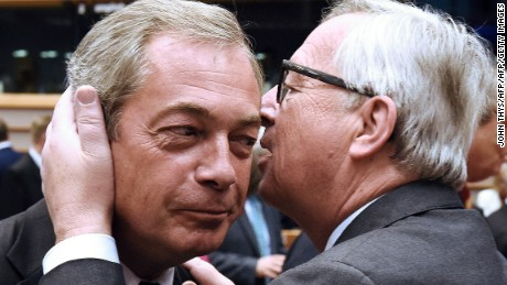 UK Independence Party (UKIP) leader Nigel Farage, left, talks with EU Commission President Jean-Claude Juncker before a plenary session at the EU headquarters in Brussels on Tuesday, June 28. European Commission chief Jean-Claude Juncker called on Prime Minister David Cameron to clarify when Britain intends to leave the EU, saying there can be no negotiation on future ties before London formally applies to exit.