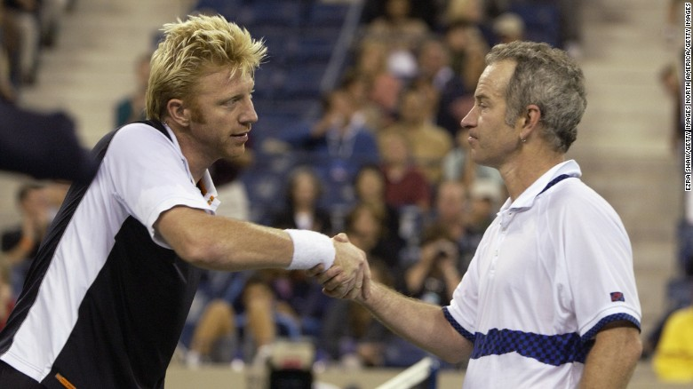 boris becker shakes hands with john mcenroe before playing an exhibition match during the us open