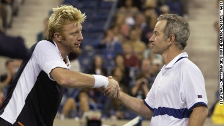 Boris Becker shakes hands with John McEnroe before playing an exhibition match during the US Open in 2002.