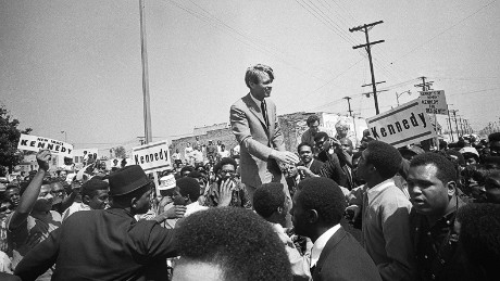 "Presidential candidate Robert F. Kennedy campaigns in the Watts neighborhood of Los Angeles in 1968. Kennerly said it was ""a brave act by a white politician to appear in the predominantly African-American section of town that so recently had been torn apart by riots after the assassination of Martin Luther King. But that was the Kennedy strength and family philosophy on display. A few weeks later, like MLK, he would also be struck dead by an assassin's bullet."""