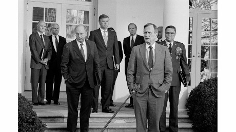 "In 1991, President Bush briefs the press in the White House Rose Garden about a possible war with Iraq. ""If you ever thought that people in power don't stick around Washington forever, this scene will relieve any doubt,"" Kennerly said. Behind Bush, from left, are National Security Advisor Brent Scowcroft, CIA Director Robert Gates, Defense Secretary Dick Cheney, Vice President Dan Quayle and Secretary of State Jim Baker. At far right is Gen. Colin Powell, who was chairman of the Joint Chiefs of Staff."