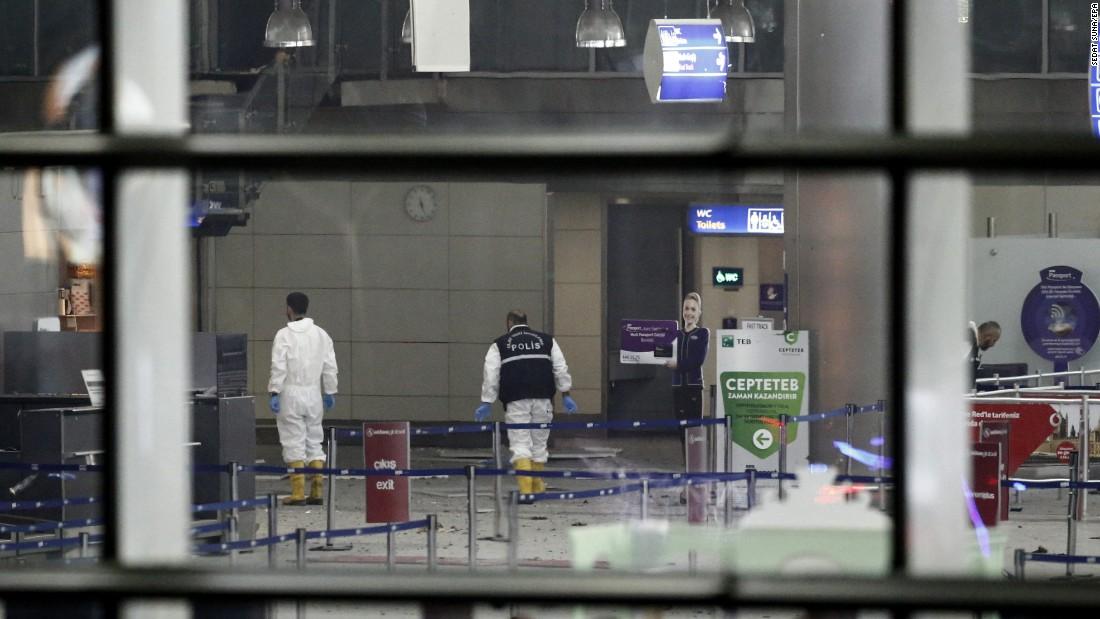 Police investigators work inside the airport.