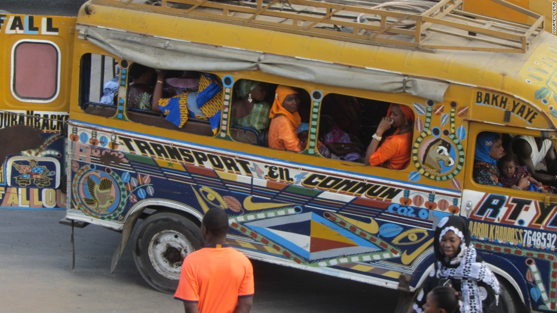 Women and children cram into a car rapides in Dakar, which the city's public transport body says are being phased out due to old age, comfort and the environmental impact of the 40-year old buses.