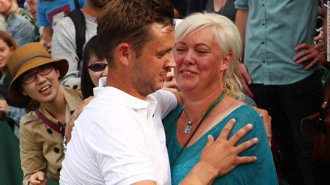 Willis celebrates with his mother after a straight-sets victory over world No. 54 Ricardas Berankis in his first senior appearance at the grass-court tournament.