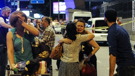 Passengers cry as they leave the airport on June 28.