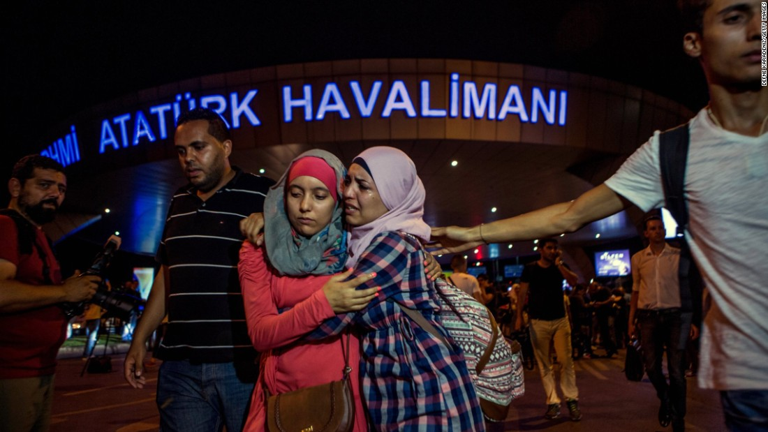 People flee the scene of a terror attack at Istanbul's Ataturk airport on Tuesday, June 28. Three terrorists armed with bombs and guns attacked the main international terminal, opening fire and eventually detonating their devices.