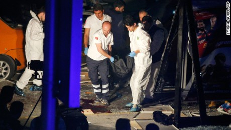Turkish rescue services carry a victim from the scene of a blast outside Istanbul's Ataturk airport, early Wednesday, June 29, 2016. Two explosions have rocked Istanbul's Ataturk airport, killing several people and wounding others, Turkey's justice minister and another official said Tuesday. A Turkish official says two attackers have blown themselves up at the airport after police fired at them. The official said the attackers detonated the explosives at the entrance of the international terminal before entering the x-ray security check. Turkish authorities have banned distribution of images relating to the Ataturk airport attack within Turkey. (AP Photo/Emrah Gurel) TURKEY OUT
