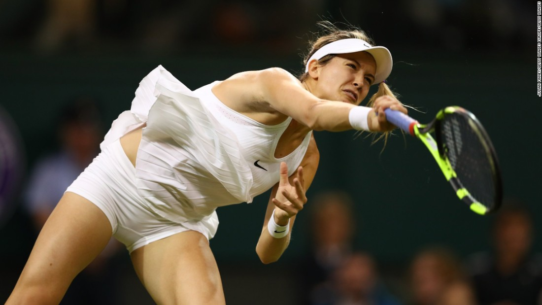 The dress is unpopular with some players, who say it reveals their midriff far too easily, as Eugenie Bouchard of Canada shows while serving. But Bouchard is one player who likes the dress.