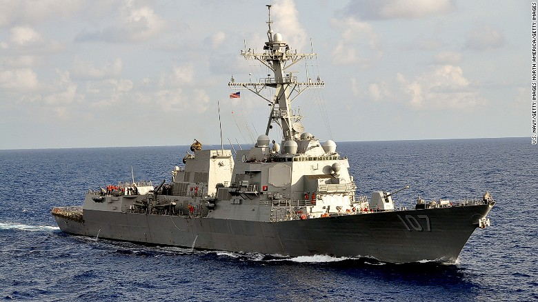 U.S. destroyer sails by Russian warship
