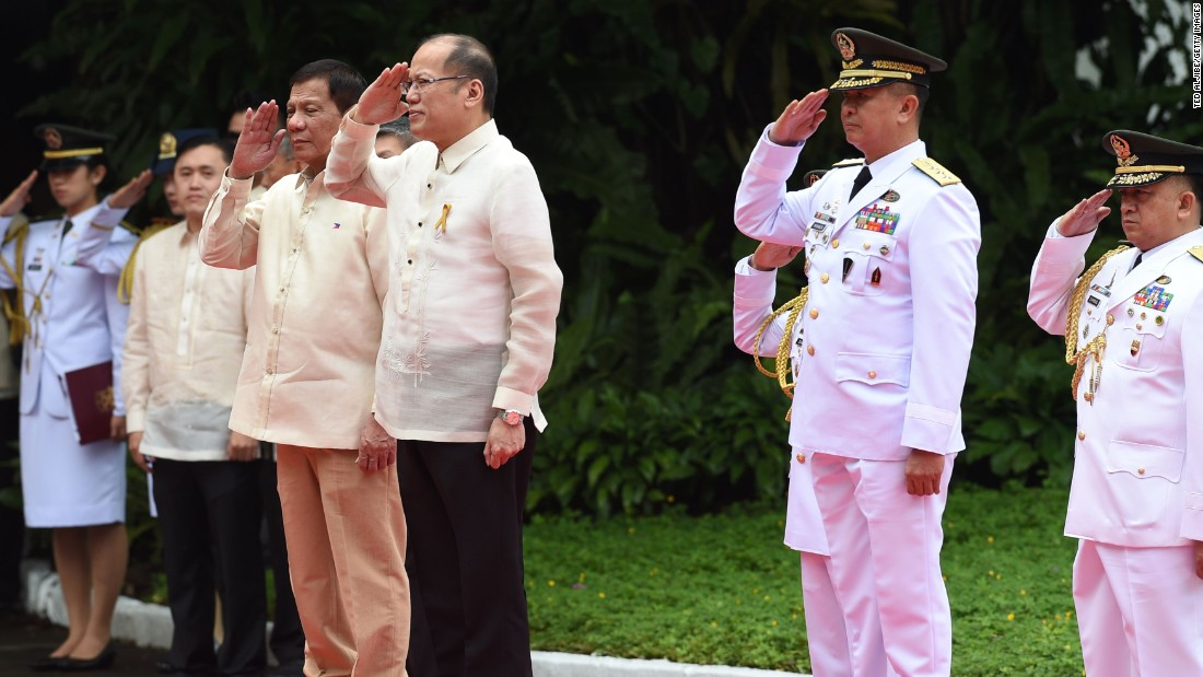 "Newly inaugurated <a href=""http://www.cnn.com/2016/06/29/asia/philippines-duterte-inauguration/index.html"" target=""_blank"">Philippines president Rodrigo Duterte</a> (center left) stands next to outgoing leader Benigno Aquino (center right), during the departure ceremony for Aquino on June 30, 2016."