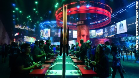 Gaming fans play the SquareEnix game 'Hitman Episode 3-Marrakesh ' at the Los Angeles Convention Center on June 16, 2016 in Los Angeles, California on the third day of the 2016 Electronic Entertainment Expo, or E3, the annual video game conference and show. / AFP / FREDERIC J. BROWN        (Photo credit should read FREDERIC J. BROWN/AFP/Getty Images)