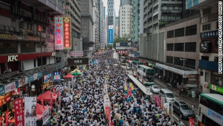 Hong Kong streets packed with protesters for July 1 march