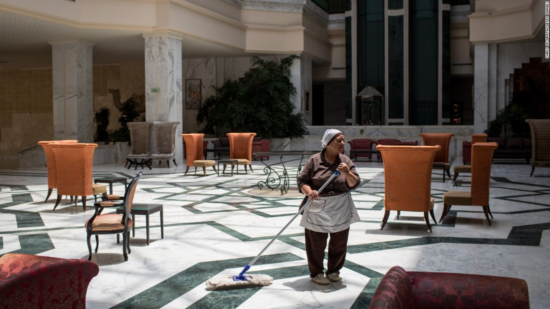 "An employee mops a floor Friday, June 24, at the closed Imperial Marhaba Hotel in Sousse, Tunisia. The hotel was the main target of <a href=""http://www.cnn.com/2015/06/27/africa/tunisia-terror-attack/"" target=""_blank"">a terrorist attack last year</a> that killed 38 people at a seaside resort. It hopes to open again by next spring or as soon as British travel restrictions are lifted for Tunisia."