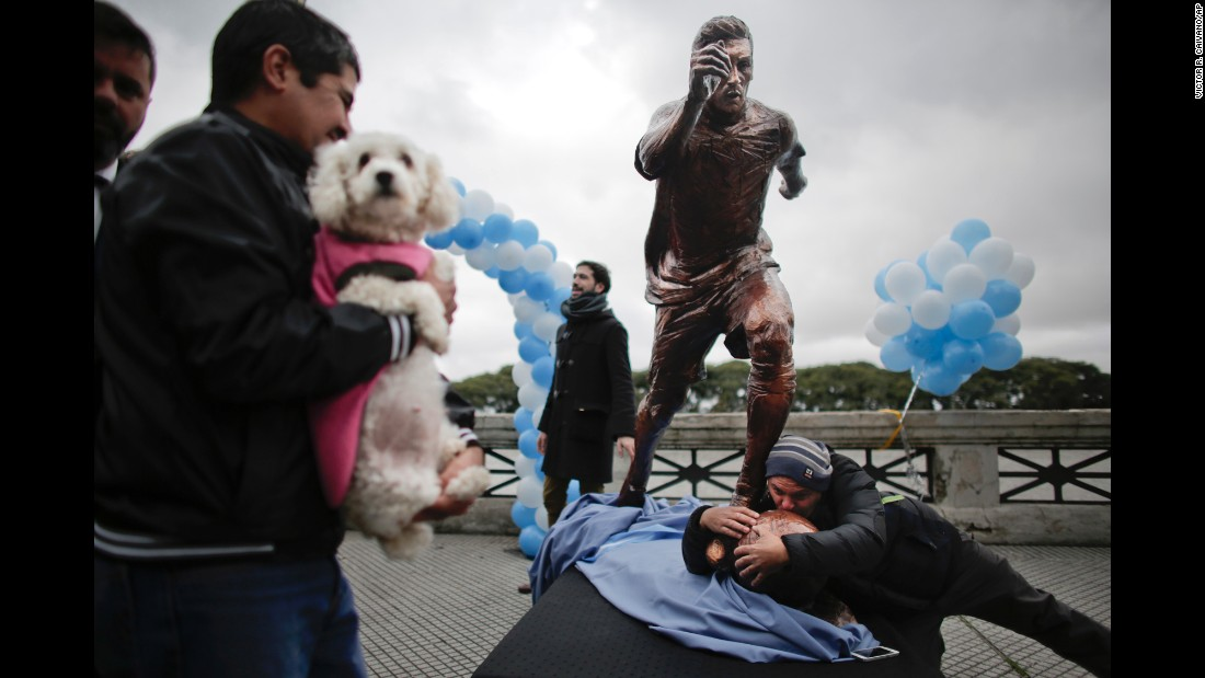 "A man kisses a statue of soccer star Lionel Messi shortly after it was unveiled in Buenos Aires on Tuesday, June 28. Fans, players and even Argentina's President have asked Messi to reconsider <a href=""http://www.cnn.com/2016/06/27/football/copa-america-lionel-messi/index.html"" target=""_blank"">his decision to retire from the national team.</a>"
