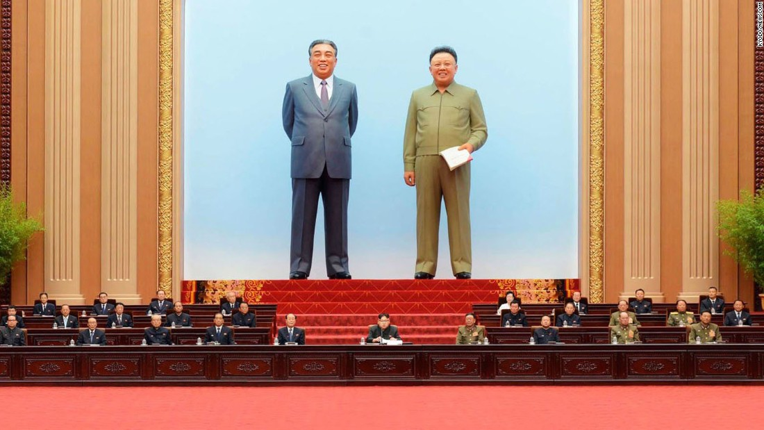 Giant images of North Korean founder Kim Il Sung, left, and former leader Kim Jong Il are seen behind current leader Kim Jong Un, center, at a session of the Supreme People's Assembly on Wednesday, June 29.