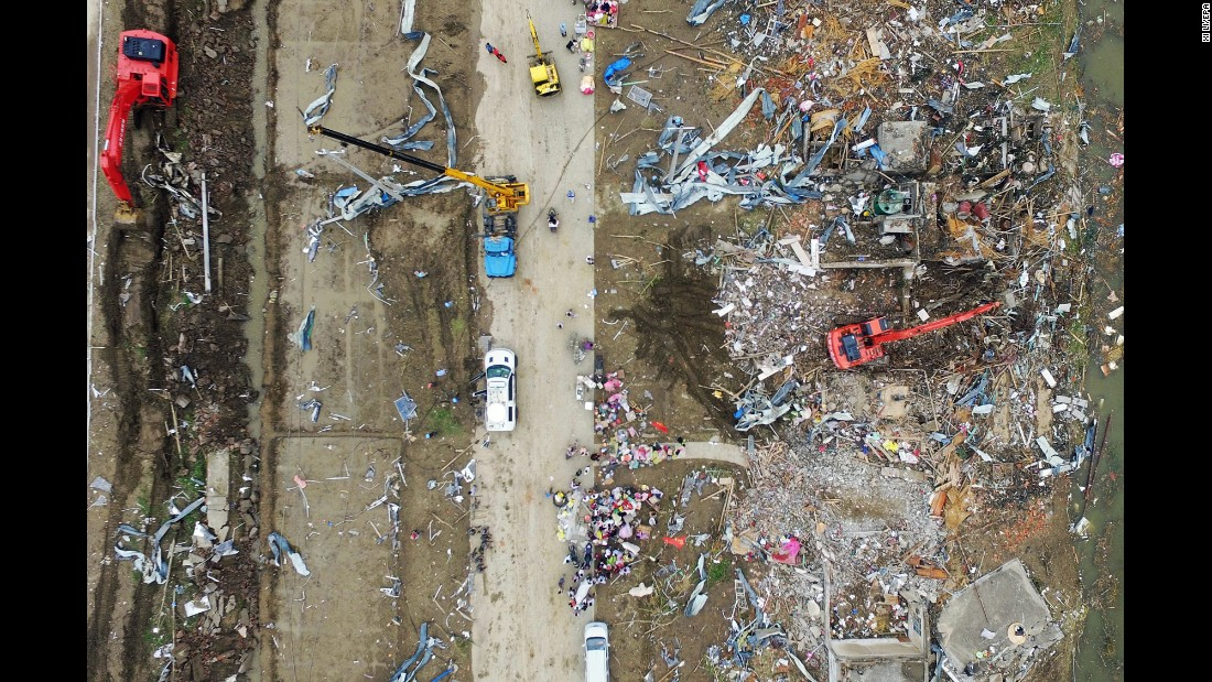 "An aerial photo on Friday, June 24, shows the damage caused by a <a href=""http://www.cnn.com/2016/06/23/asia/china-tornado/"" target=""_blank"">deadly tornado</a> in China's Jiangsu Province. At least 98 people were killed and 800 more were injured, the government said."